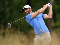 Johnson holds clubhouse lead at weather-hit US Open