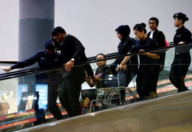 Chaotic scenes as suspects wheeled around airport where N.Korean leader's brother killed