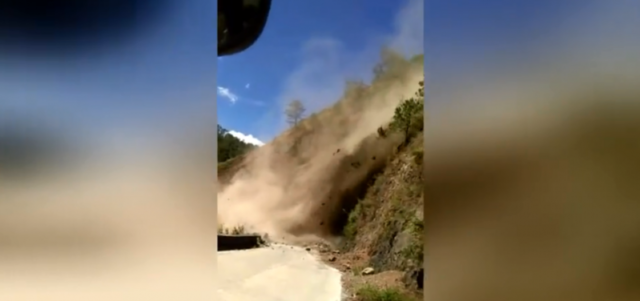 Terrifying moment bus passengers scream after getting stuck yards from landslide (video)