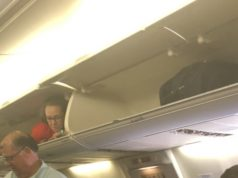 Flight attendant found hiding in overhead luggage bin! (video)