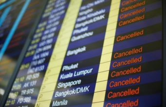 Hong Kong airport grinds to a halt as protests swell