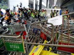 Trains to Hong Kong airport suspended amid protester disruption