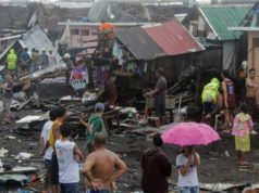 One killed as typhoon hits Philippines, hundreds of flights halted