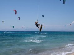 People kite surf at Mylos beach
