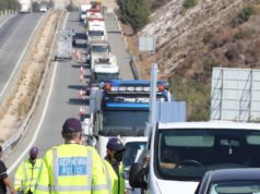Highways clog as authorities issue travel ban specifics