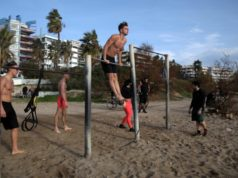 Greeks escaped lockdown for the beach as winter temperatures soared