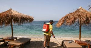 Hoping to lure back tourists, Greece reopens beaches after lockdown